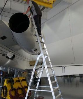 15' LNC Pylon Engine Ladder with technician examining outside of engine of Gulfstream V Jet