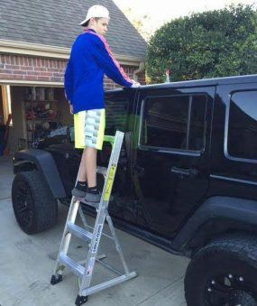 5' LNC Lite Aluminum Ladder washing Jeep from side