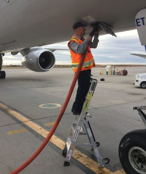5 Foot Mini Pylon With Technician Feeding In Hose To Boeing 757 On Tarmac