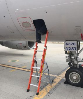 Ee Lite Ergonomic Safety Ladder With Technician High Inside Access Panel Of Airbus A320 On Tarmac