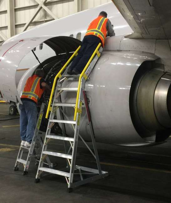 10 Foot Cowl Pylon MAX And 5 Foot Mini Pylon Side By Side With Technicians Working On Different Areas Of Engine On Boeing 737