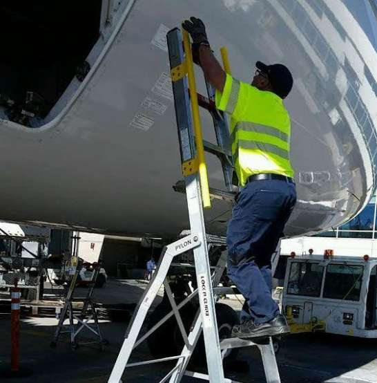 10' LNC Pylon Engine Ladder with technician climbing to cargo access door on Boeing 787