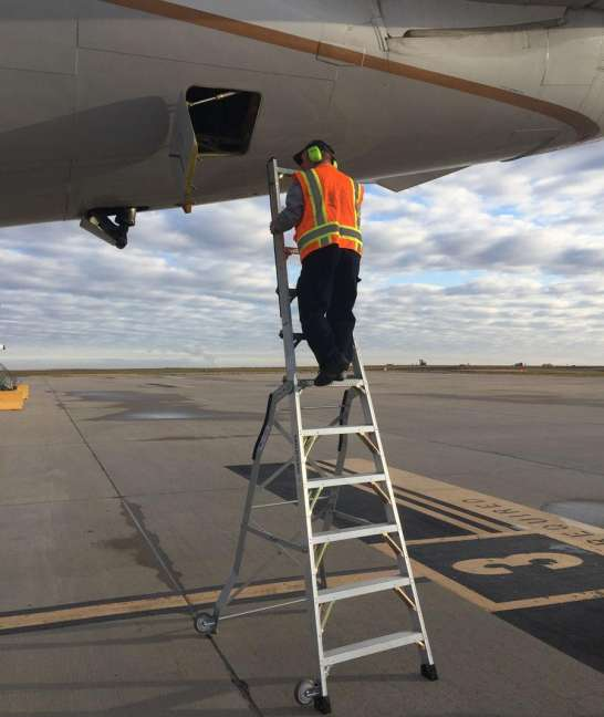 11 Foot Lnc Pylon With Technician Climbing Up To Check Section 48 Panel On Boeing 757 On Tarmac