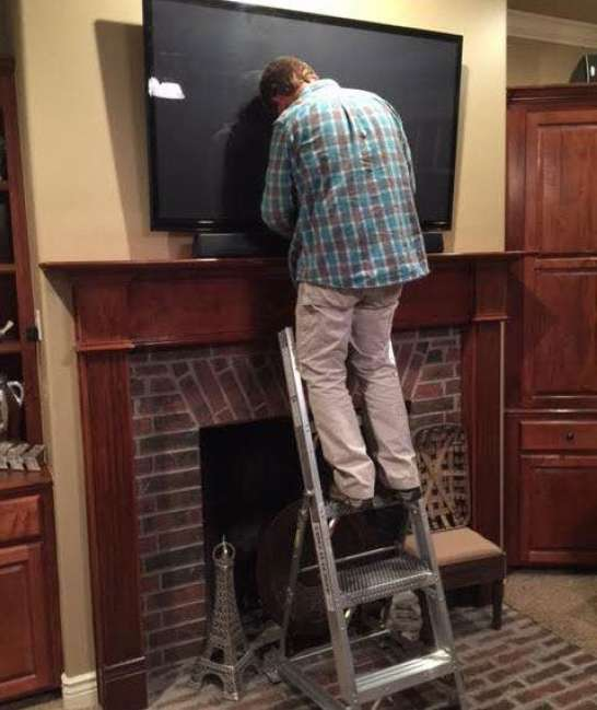 5' LNC Lite Aluminum Ladder in home working on TV