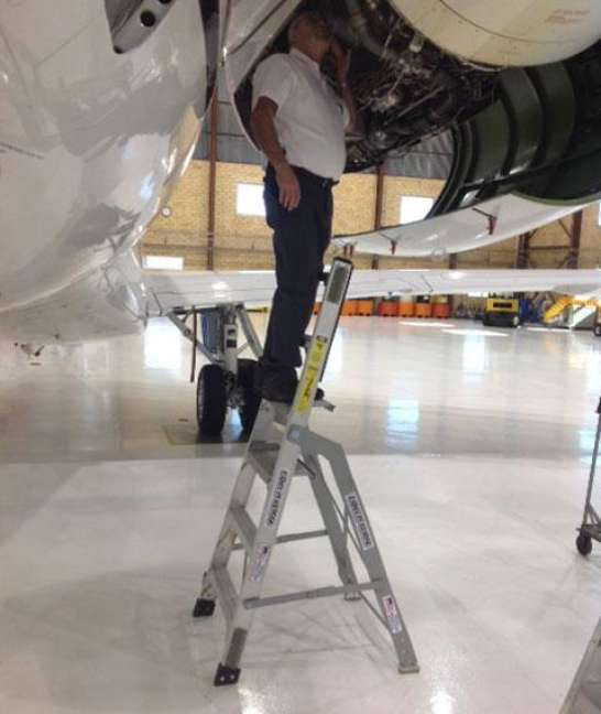 6' LNC Pylon Engine Ladder with technician examining panel access on Embraer 135