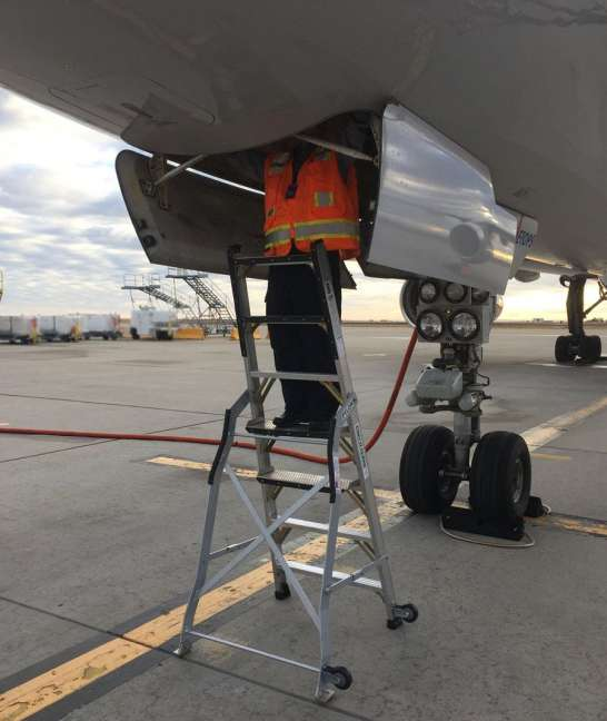7 Foot Lnc Pylon With Technician Working In Access Panel Under Boeing 757 On Tarmac