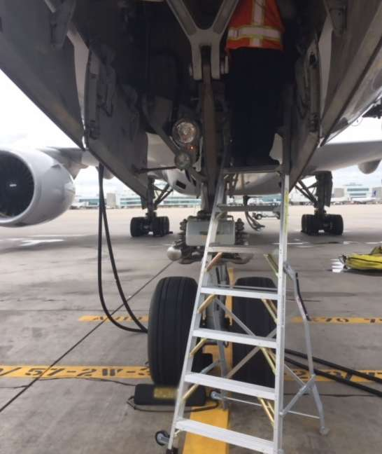 7 Foot Lnc Pylon With Technician Working In Nose Gear Door Of Boeing 777 On Tarmac