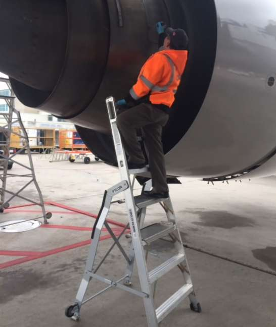 7 Foot Lnc Pylon With Technician Working On Engine Thruster Of Boeing 777 On Tarmac