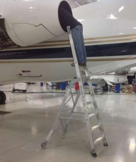 8' LNC Pylon Engine Ladder with technician checking inside engine of Embraer 650