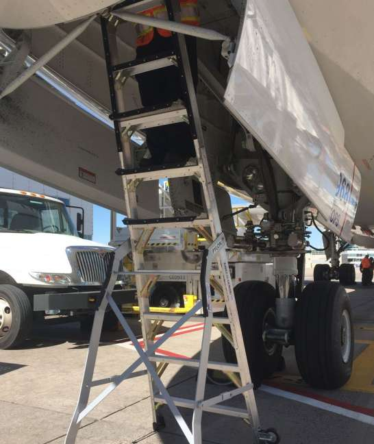 9 Foot Lnc Pylon Ladder With Technician Working In Nose Gear Door Of Boeing 787 On Tarmac2