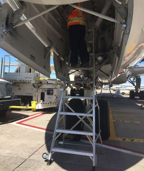 9 Foot Lnc Pylon Ladder With Technician Working In Nose Gear Door Of Boeing 787 On Tarmac3