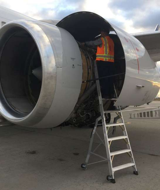 9 Foot Lnc Pylon With Technician Working In Engine On Boeing 757 On Tarmac