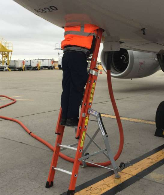 Ee Lite Ergonomic Safety Ladder With Technician Halfway Inside Access Panel Of Airbus A320 On Tarmac