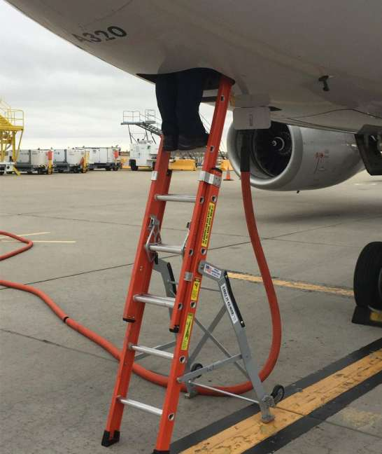 Ee Lite Ergonomic Safety Ladder With Technician High Inside Access Panel Of Airbus A320 On Tarmac Second Shot