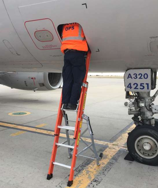 Ee Lite Ergonomic Safety Ladder With Technician Inside Access Panel Of Airbus A320 On Tarmac
