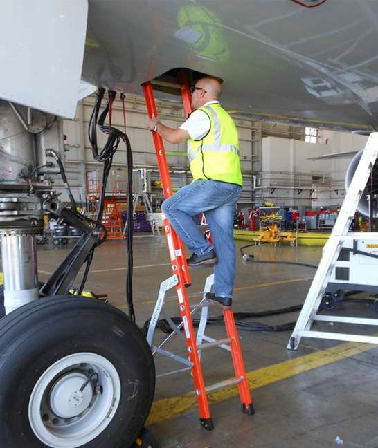 E&E Lite Ergonomic Safety Ladder in Boeing 777 E&E compartment with technician climbing up