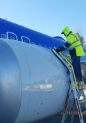 10 Foot Cowl Pylon Max With Technician Servicing Engine Of Boeing 737 Max On Tarmac