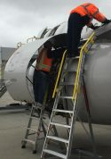 10 Foot Cowl Pylon Next To A 6 Foot Lnc Pylon With Technicians Working On Cowl Engine Area Of Airbus A320 On Tarmac