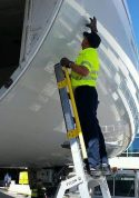 10' LNC Pylon Engine Ladder with technician reaching to cargo access door on Boeing 787