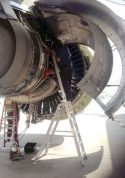 11' LNC Pylon Engine Ladder on tarmac with technician servicing engine of Boeing 777