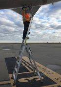 11 Foot Lnc Pylon With Technician Checking Underside Of Tail On Boeing 757 On Tarmac