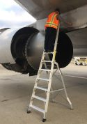 11 Foot Lnc Pylon With Technician Working Above Engine On Boeing 757 On Tarmac