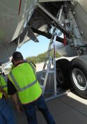 13' Gear & Wheel Well Cadet Ladder being put in position above wheels of Boeing 787