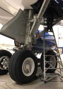 13 Foot Gear And Wheel Well Cadet With Technician Working In Gear Well Of Airbus A350 In Hangar Second Shot