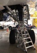 13 Foot Gear And Wheel Well Cadet With Technician Working In Gear Well Of Airbus A350 In Hangar Third Shot