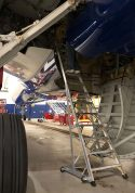 13 Foot Gear And Wheel Well Cadet With Technician Working In Wheel Well Of Airbus A350 In Hangar Second Shot