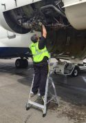 6' LNC Pylon Engine Ladder with technician on MD80-90 series on tarmac