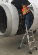 6 Foot Lnc Pylon With Technician Working In Engine Of Boeing A320 On Tarmac Second Shot