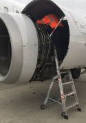 6 Foot Lnc Pylon With Technician Working In Engine Of Boeing A320 On Tarmac