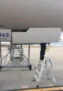 7 Foot Lnc Pylon With Technician Working In Access Panel Under Boeing 757 On Tarmac Second Shot
