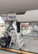 7 Foot Lnc Pylon With Technician Working Next To Wheel Under Boeing 757 On Tarmac