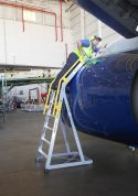 9' Cowl Pylon Ladder on Boeing 737 engine with technician stretching