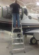 9' LNC Pylon Engine Ladder with technician servicing engine of Embraer Phenom 300