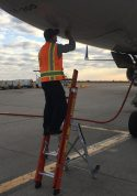 Ee Lite Ladder With Technician At Access Panel Of Boeing 757 At Tarmac
