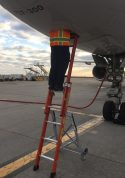 Ee Lite Ladder With Technician In Access Panel Of Boeing 757 At Tarmac