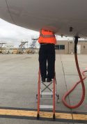 Ee Lite Ergonomic Safety Ladder With Technician Halfway Inside Access Panel Of Airbus A320 On Tarmac Second Shot