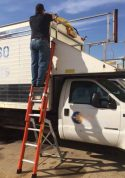 E&E Lite Ergonomic Safety Ladder in use on commercial truck
